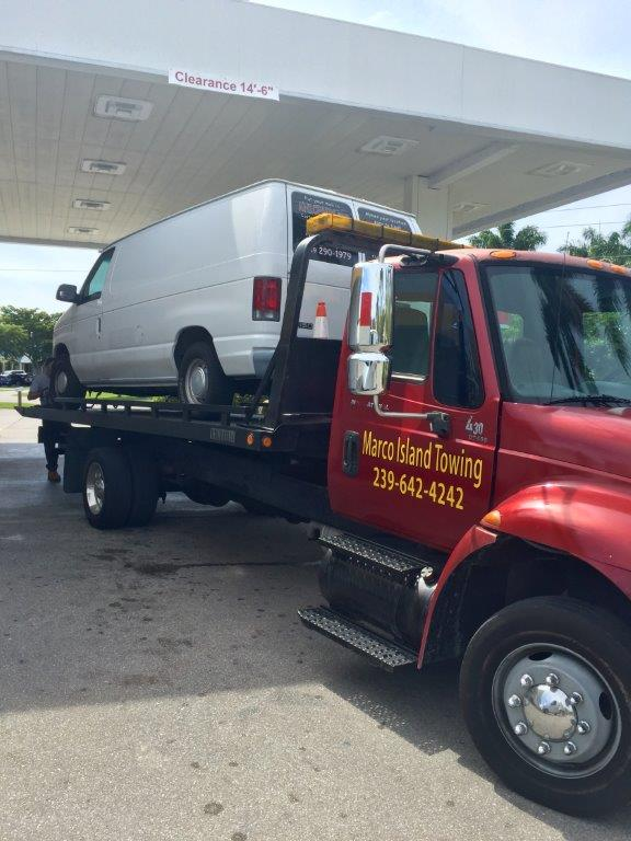 Marco Island towing company truck at shell